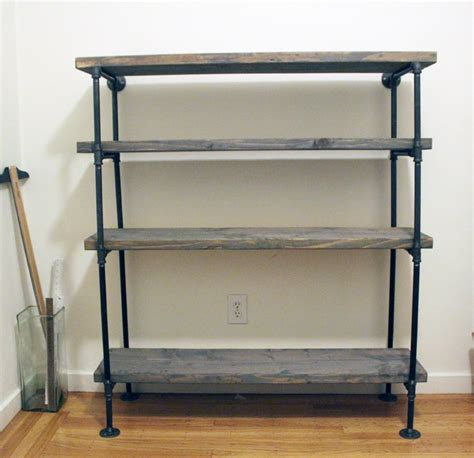 black pipe and wood shelf shelves