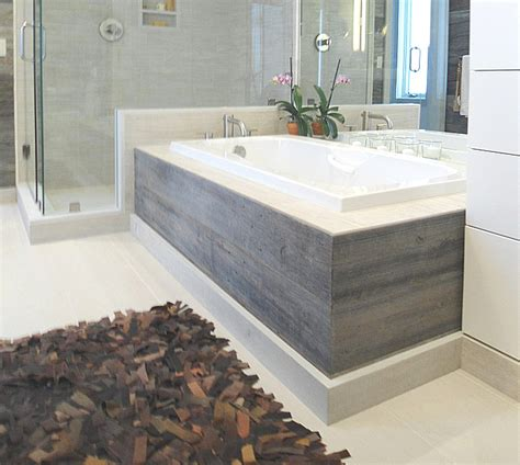 wood around bathtub the barn siding is also used as the tub skirt