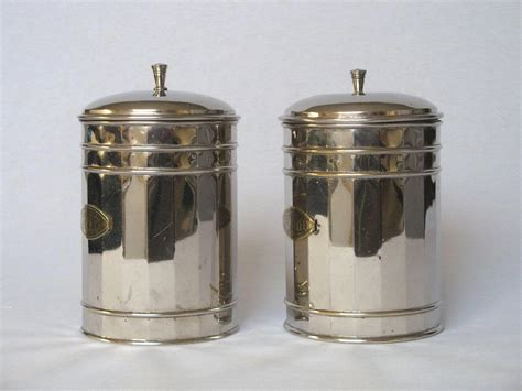 vintage french enamel kitchen canisters a pair chairish pair of vintage french chrome plated kitchen canisters