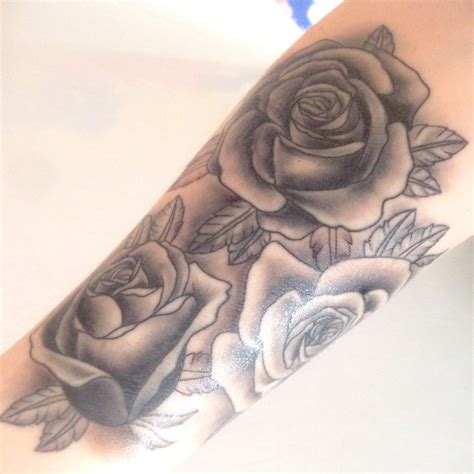 multiple rose tattoos black on forearm signifies my family two