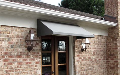 Door Awning by Awnings Door Black Fabric Awning Installed Front