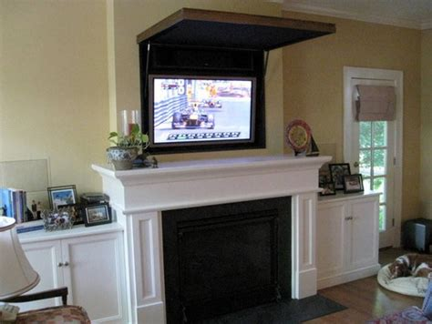 hiding a flat panel tv above a fireplace for the home