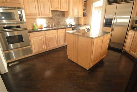 maple kitchen cabinets with dark wood floors dark