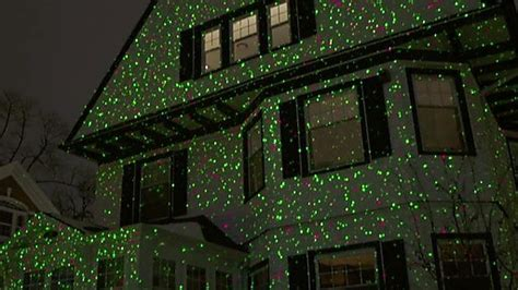 christmas lights projected on house starburst laser light projector green and