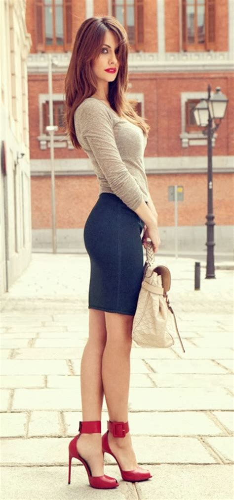 stylish mini skirt with blouse handbag and high heels