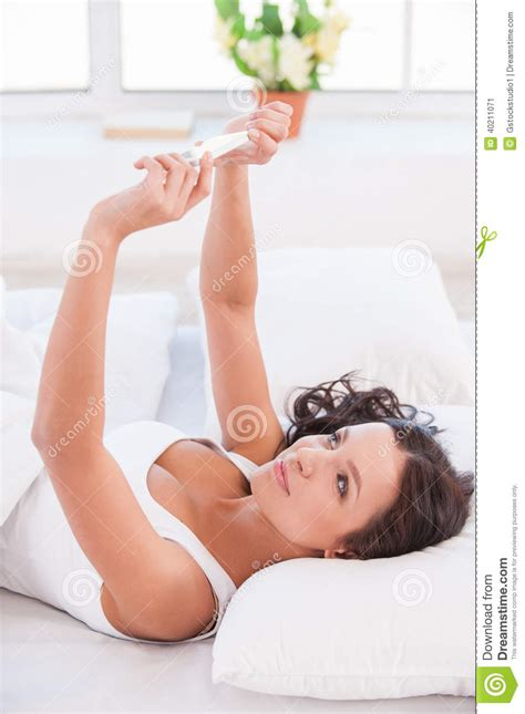 selfie in bed making selfie stock photo image 40211071