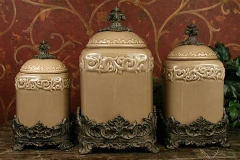 tuscan style kitchen canister sets drake design large fleur de lis taupe canister set gardens taupe and home