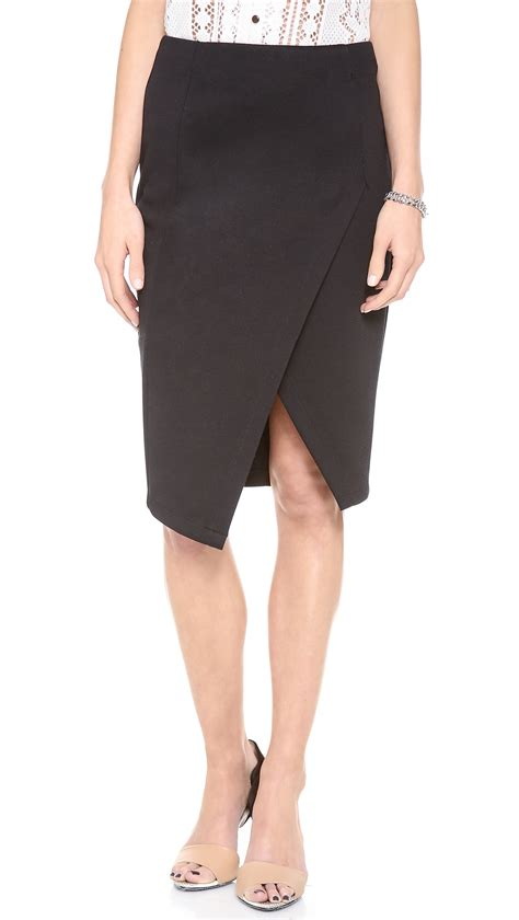 re named high waisted front slit skirt in black lyst