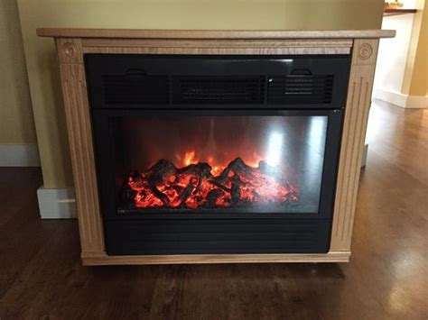 heat surge amish electric fireplace heater in blond oak