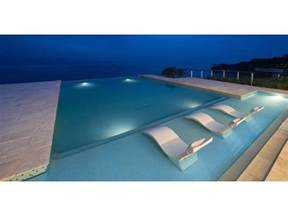 ledge lounger in pool chaise sandstone llcd ss
