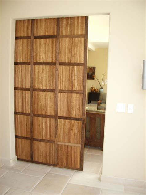 Hanging A Interior Door Interior Hanging Doors Walnut And Zebra Wood Hanging Door Contemporary Interior Doors Los