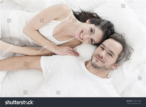 lovely couple in bed lying in bedroom lovely couple lying in bed stock photo 170213933