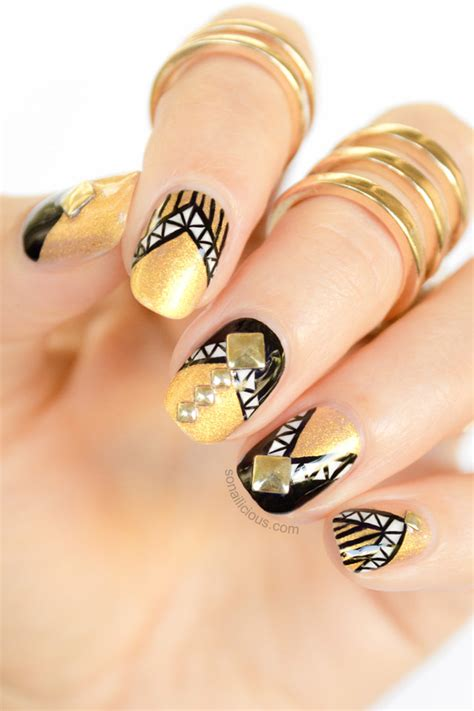 gold nail design armoured black and gold nails with studs