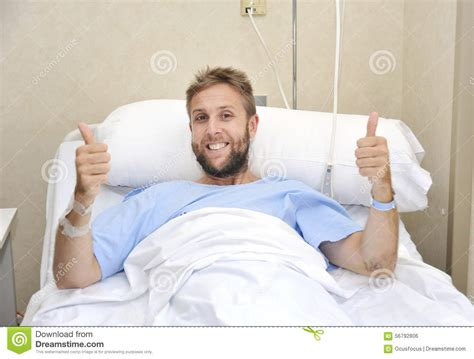 guy in hospital bed young american man lying in bed at hospital room sick or