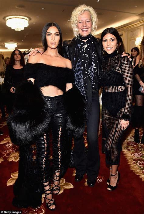 catch up with kim kardashian kim kardashian flashes taut tummy with kourtney at paris