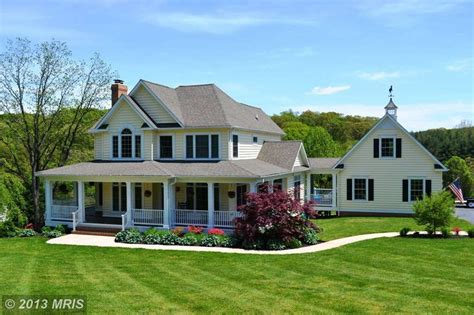 my dream home com colonial home with wrap around porch and separate garage
