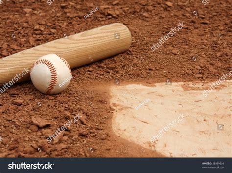 baseball bat up near home plate stock photo