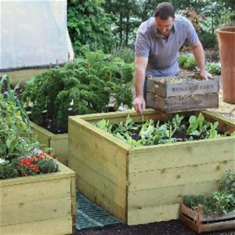 how deep should a raised garden bed be raised bed gardening how to start a raised bed vegetable