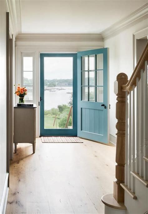 foyer entrance blue front door with blue screen door cottage entrance