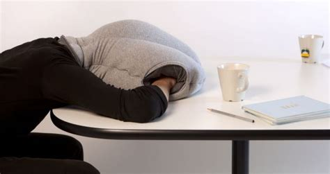 sleep on desk ostrich pillow allows workers to sleep on the metro news