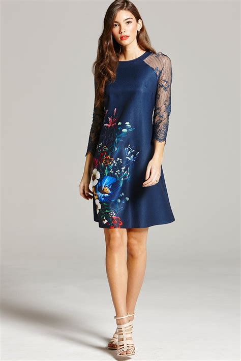 Dress And Fell Navy Floral Lace navy floral print and lace sleeve dress from uk