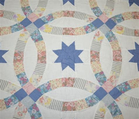 vintage quot double wedding ring quot quilt with 8 point blue star c