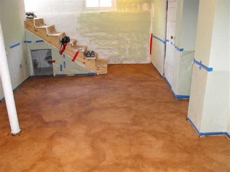 painting unfinished epoxy basement floor with brown color decor after makeover and wall with