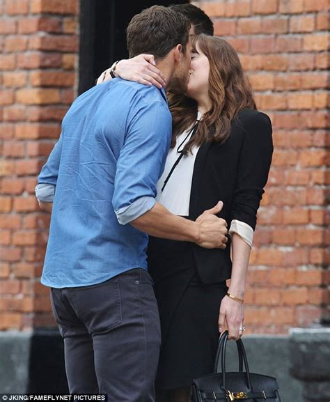 fifty shades of grey actors dislike each other jamie dornan plants a kiss on dakota johnson as they film