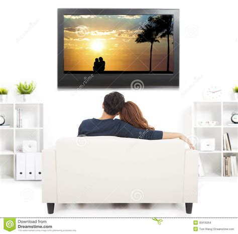 sofa for watching tv young couple on sofa watching tv with remote control
