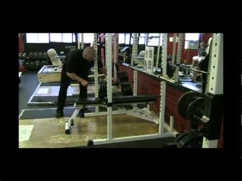 bench press with safety bars adjusting the power rack and safety bars for the bench