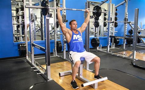 seated barbell press seated barbell shoulder press exercise guide tips