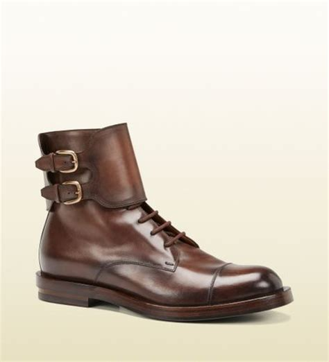 gucci brown leather buckle boot in brown