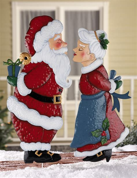kissing santa or mrs claus christmas outdoor metal garden