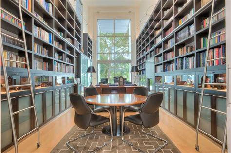 Two Story Fireplace luxury living private libraries christie s