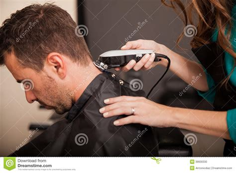 men hair salon getting haircut at a salon stock photo image 39930330