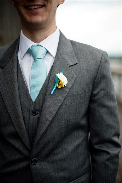 the tealish blue tie with gray suit when i say i do