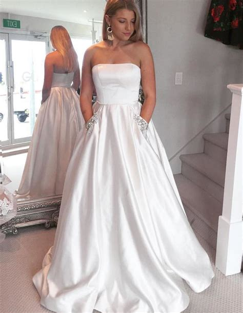 beaded white gown graceful strapless beaded white satin gown with