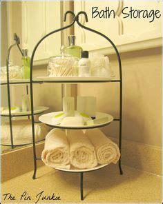 i need a bathroom now diy decorative bath towel storage inspiration using two drapery tassels secure two
