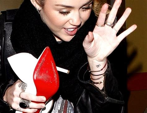 miley cyrus om on wrist meaning story of
