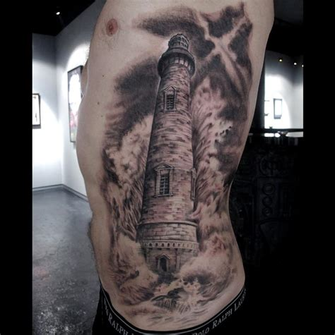 lighthouse tattoo chest pictures to lighthouse on side rib by stefano alcantara