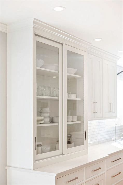 kitchen cabinets with sliding doors 25 best ideas about glass cabinet doors on pinterest