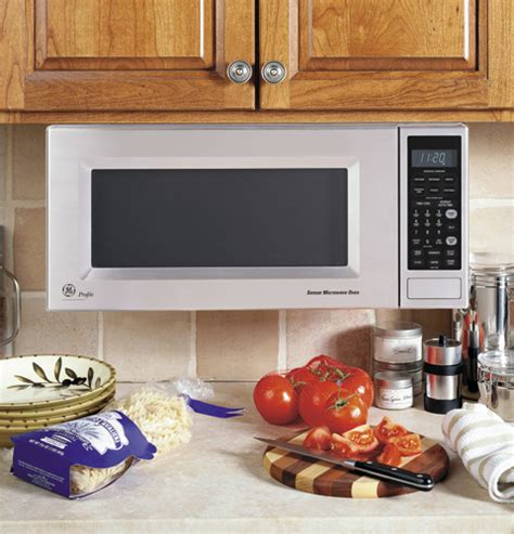 hang microwave under cabinet ge microwaves and microwave shelf hanging kits