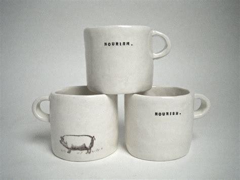 Cups. ? Rae Dunn  clay
