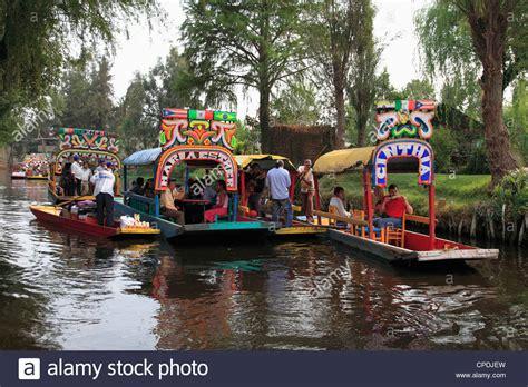 floating boats mexico city brightly painted boats xochimilco trajinera floating