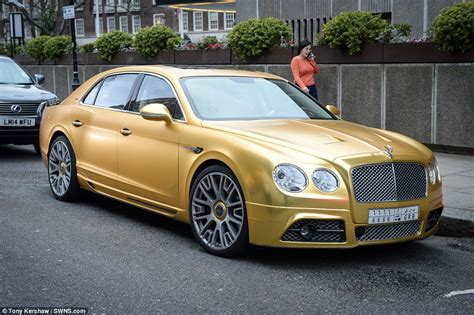 bentley car gold garish pink lamborghini covered in photographs of