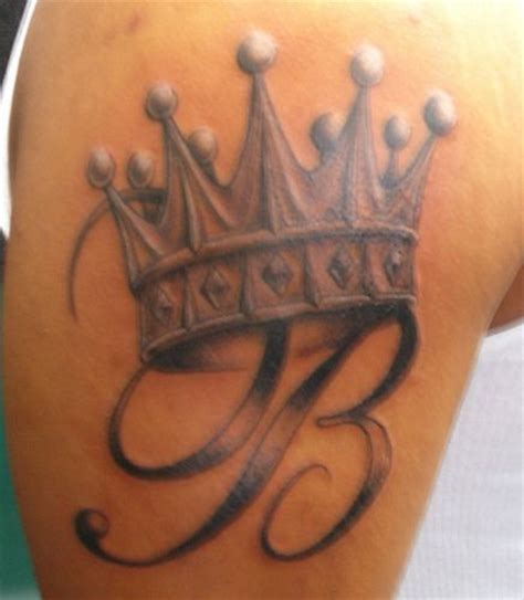 king crown tattoo something similar maybe jk under it