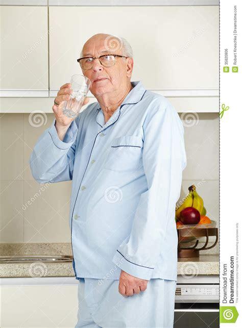3d Kitchen Design App senior man drinking water royalty free stock image image