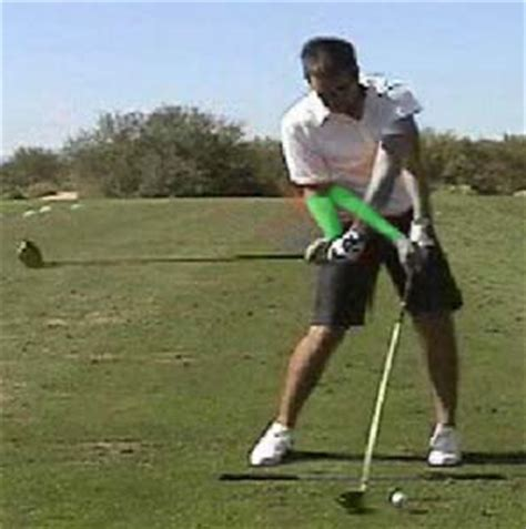 right elbow in the golf swing downswing