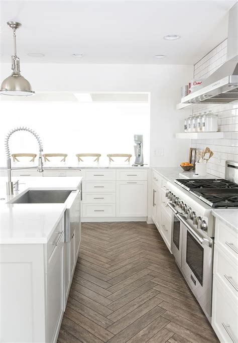 wood floor in kitchen best 25 herringbone tile floors ideas on tile