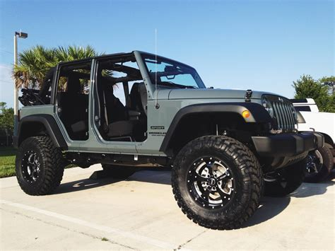 stock jeep wheels and tires check out this 2014 jeep wrangler with bmf wheels and lift
